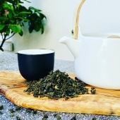 Tie Kuan Yin, a high quality Oolong tea from the Fujian province in China, formerly reserved for the Imperial Court.   Oolong is neither a black nor a green tea; Oolong actually represents its own category.   Where as black tea is completely oxidized and green tea barely at all, Oolong tea is only partially oxidized.   The leaves of the Tie Kuan Yin are oxidized to about 40%. They are heavy, dark green and tightly rolled. The brewed tea has a bright yellow (gold) color with a floral aroma.   As for the taste, it is quite full and balanced and slightly floral with hints of stone fruit, caramel or chestnut.   Personally I love the mild and friendly character of the Oolong teas and in particular the Tie Kuan Yin, a lot. It is such an elegant and tasteful alternative for the often bold and outspoken green and black teas.   Het Kleinste Huis offers a lovely range of Oolong teas and blends for you to explore. Available in store and online (link in bio).  Be sure to check it out!  If you are in need of any further information, just contact us by DM and we will try our best to help you out!   #thee #tea #tiekuanyin #oolong #oolongtea #theedrinken #theezetten #teatime #chinesetea #looseleaftea #lossethee #theewinkel #teashop #hetkleinstehuis #smallesthouse #thesmallesthouseinamsterdam #tealoversofinstagram #ilovetea #tealovers #insteagram #amsterdam #theewinkelamsterdam #theespecialist #amsterdamcravings #amsterdamfoodies #healthylifestyle #healthyliving #mindfulness #mindfulliving